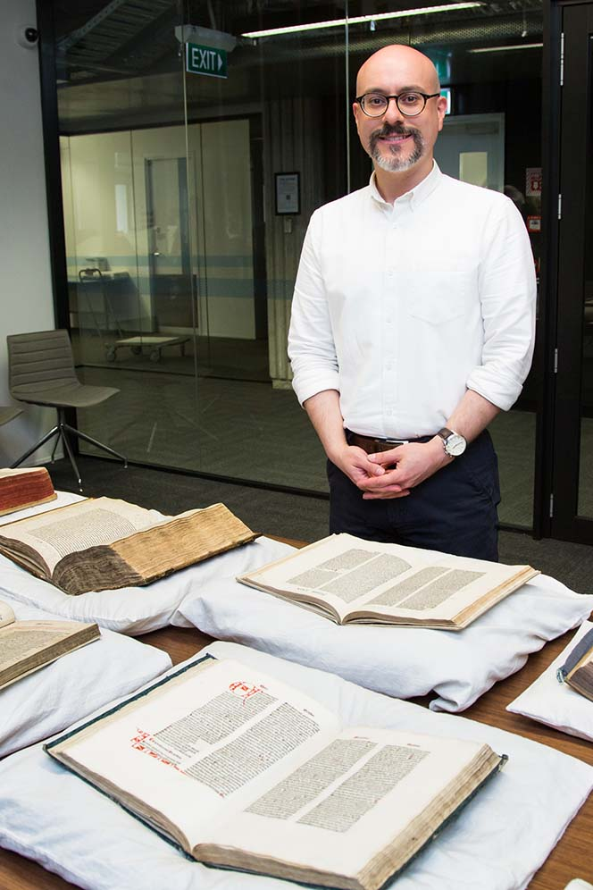 Anthony Tedeschi (Curator Rare Books and Fine Printing) with books from the John Barton Collection. Photo by Mark Beatty.